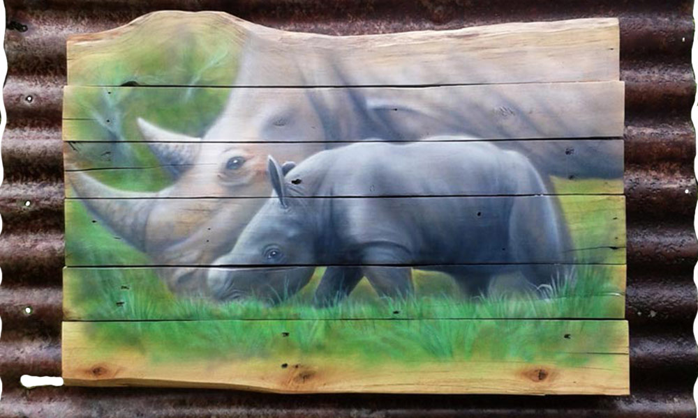 Airbrushed Acrylic on Wood planks. Mother and child Rhino' 1000mmx 600mm mounted on rusted corrugated iron roof sheet